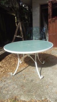 2 matching white metal/glass outdoor tables $35ea  Orlando, 32806