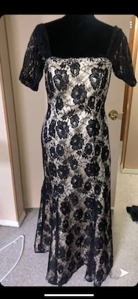 Lace black and nude dress worn once bought for 150 size 10 to 12