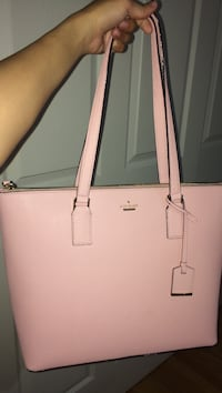 Brand new Kate Spade not my color although it's super cute 290 willing to negotiate  West Point, 84015