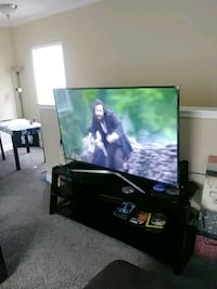 black flat screen TV with remote Gulfport, 39503