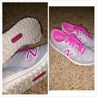 pair of gray-and-pink Nike running shoes Brunswick