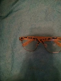 brown and black leopard print clubmaster eyeglasses
