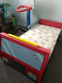 Firetruck bed with crib mattress.