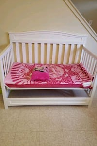 baby's white wooden crib with matters Alexandria, 22314