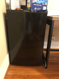 black and gray compact refrigerator 1139 mi