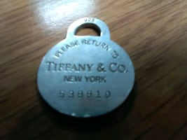 Return to Tiffany's silver pendant with registration number