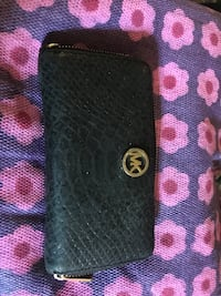 This MK black wallet does have lots of normal wear but no rips and zi Las Vegas, 89108
