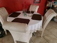 Glass table and four chairs  Kissimmee, 34744