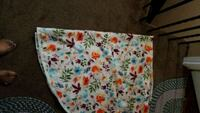 white, blue, and red floral tote bag 551 km