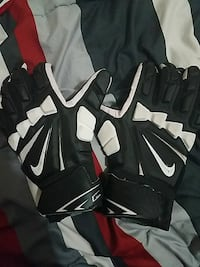 pair of black-and-white Nike gloves