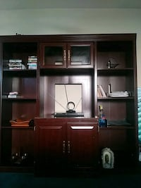 brown wooden TV hutch with flat screen television San Antonio, 78201