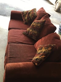 Brick red couch with three throw pillows Silver Spring, 20904
