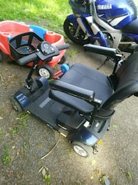 black and blue mobility scooter paid 1750 for it  367 km