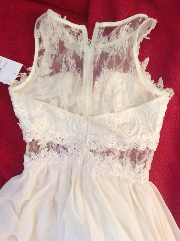 women's white sleeveless dress c3d0eb0c-f45f-4646-9c11-97e4d9d104d4