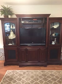 brown wooden TV hutch with flat screen television San Antonio, 78247