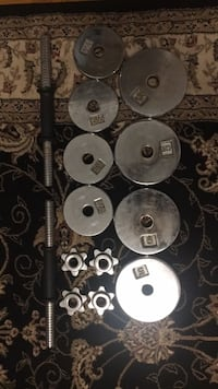 Six silver barbell plates and dumbbells Toronto, M1T 1A6