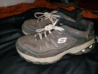 pair of black-and-gray Nike running shoes Mission, V2V