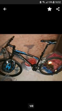 black and blue Salcano hardtail mountain bike Dagenham, RM10