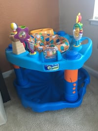 Blue and multicolored exersaucer walker