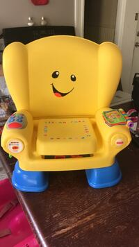 Toddler's yellow and blue laugh and learn booster seat Woonsocket, 02895