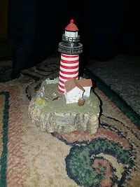 red and white lighthouse ceramic table decor