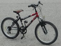 """BOYS OR GIRLS 20"""" CARRERA CLASH 6 SPD WITH SUSPENSION QUICK PRICE AT $85.00 FIRM!"""