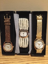 three gold-colored analog watches with boxes Caledon, L7K 0C9