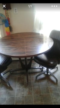 Round brown wooden table with four chairs dining set Ellenville, 12428