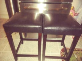Brown bar stool they are 60 for both stools they are very sturdy