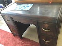 brown wooden single pedestal desk 1961 km