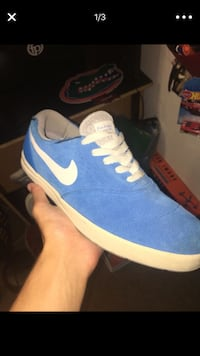 unpaired blue and white Nike low-top sneaker screenshot Clearwater, 33761