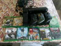 black Xbox One console with controller and game cases Takoma Park, 20912