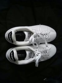 pair of white Adidas low-top sneakers Greenville, 27834