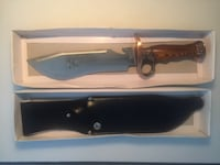 brown and black hunting knife with sheath null