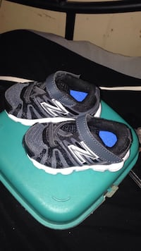 pair of black-and-white Adidas running shoes Jacksonville, 72076