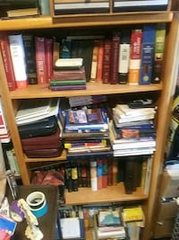 Shelf Of Old Bibles concordances and study books..