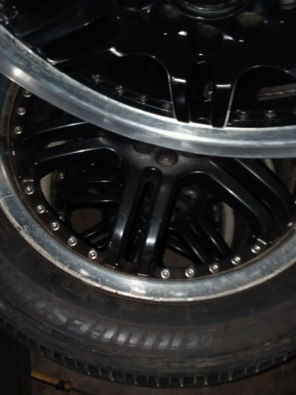 "nice set of 17 "" black rims with chrome lip. need them gone  quick. c72f6066-d8dc-4949-b3eb-4b08568458ca"