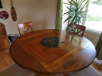 oval brown wooden dining table Victoria, V9C 1B1