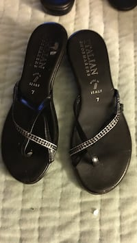 Pair of black leather sandals