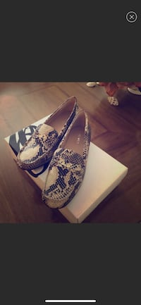 pair of white-and-blue floral flats null