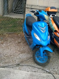 blue and black motor scooter 385 mi