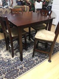 Dark cherry dining table w/4 chairs. New was over $300. Very clean. BO