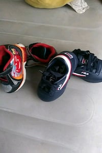 Pair of red white and blue FILA and a pair of ca Charleston, 29403