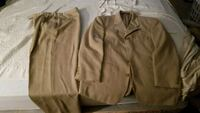 Tan two piece suite very good condition  Saginaw, 48609