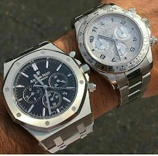 two round silver chronograph watch with silver link bracelet