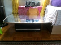 brown wooden framed glass top coffee table Arlington, 22201
