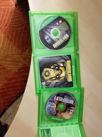 three Xbox One game discs with cases