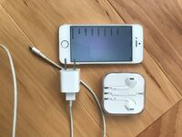 Gold iPhone 5s with UNOPENED ear buds and a charger. blue case. Charlotte, 28203