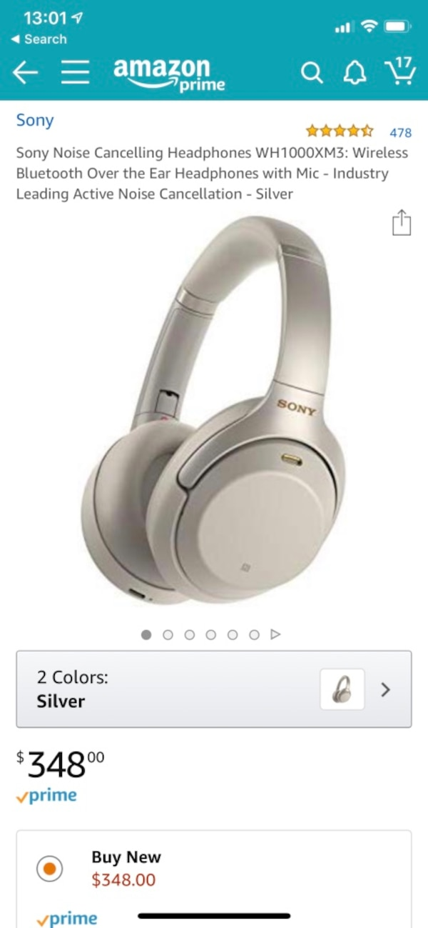 white and gray corded headphones