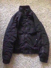 New black windbreaker size large. Colton, 92324
